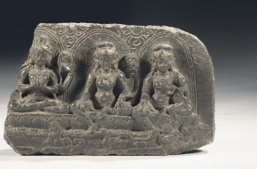 A Northeast Indian phyllite stone stele depicting three female deities