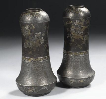 A pair of bronze komai vases
