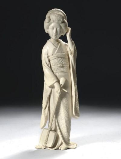A large ivory Tokyo School oki