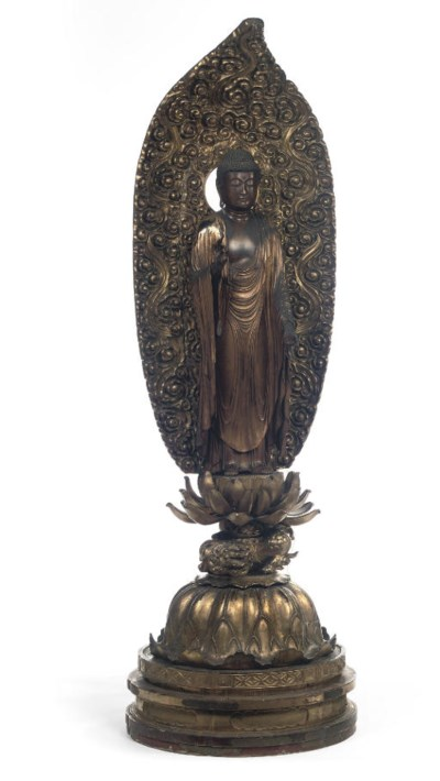 A large gilt wood figure of Am