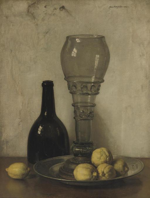 A bottle, roemer and lemons on a ledge