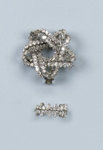A DIAMOND BROOCH WITH RING