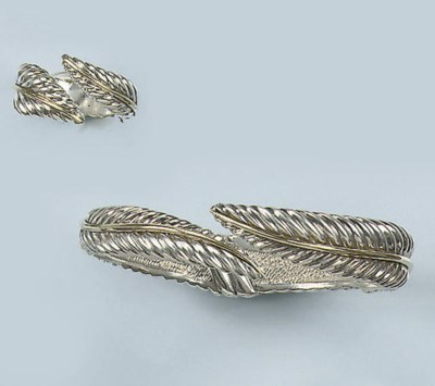 A SILVER AND GOLD BANGLE AND R