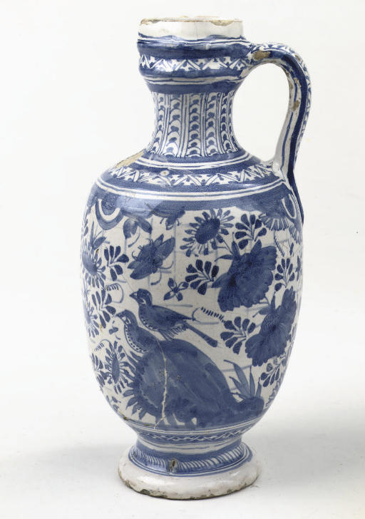 An early Dutch Delft blue and white chinoiserie jug