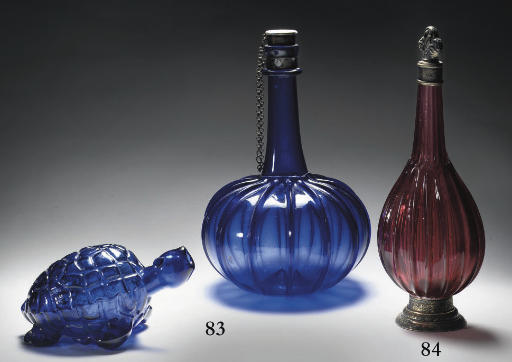 A Southern Netherlands silver-mounted decanter and stopper and a pressed glass 'turtle' spirit flask