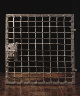 A WROUGHT-IRON WINDOW GRILL