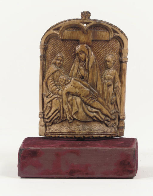 A RELIEF CARVED IVORY PAX DEPI