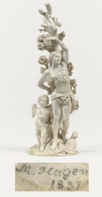 A CARVED IVORY GROUP OF SAINT