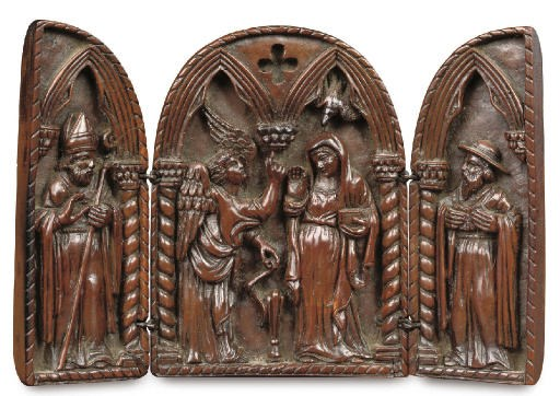 A RELIEF CARVED WOOD TRYPTICH
