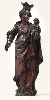 A CARVED FRUITWOOD GROUP OF TH