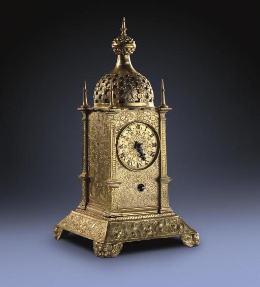 A German small engraved gilt-brass and gilt-copper striking tischuhr