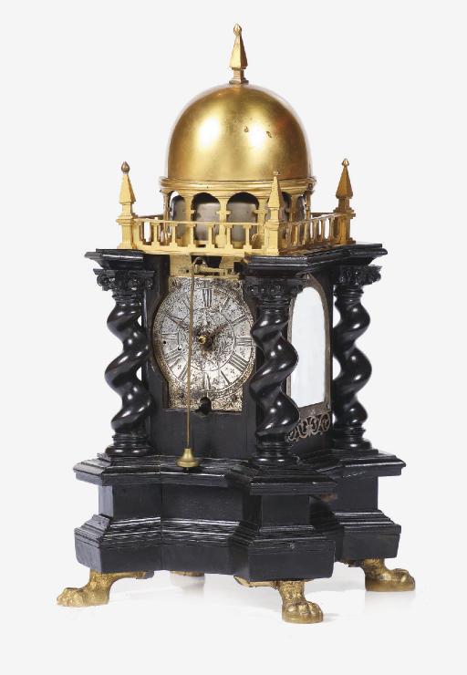 A Central European ebony and gilt-brass quarter-striking table clock
