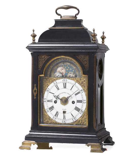 A Dutch small ebonised and brass-mounted striking table clock with moonphase and alarm
