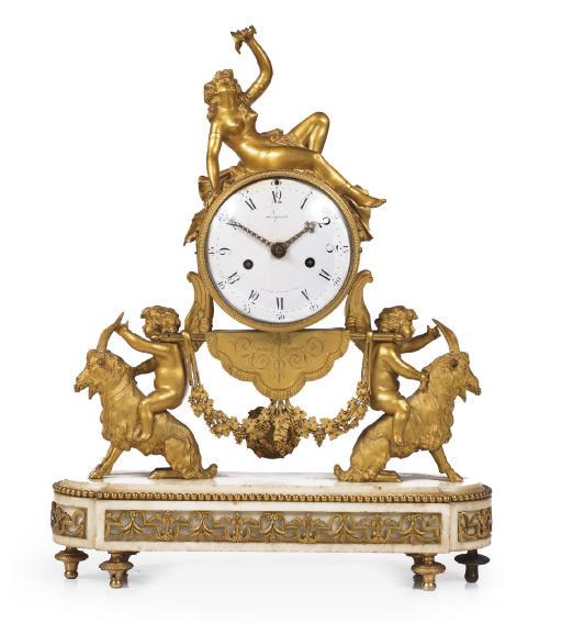 A Louis XVI ormolu and white marble striking figural mantel clock