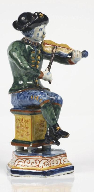 A Dutch Delft polychrome figur