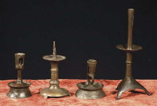 A group of four brass candlest