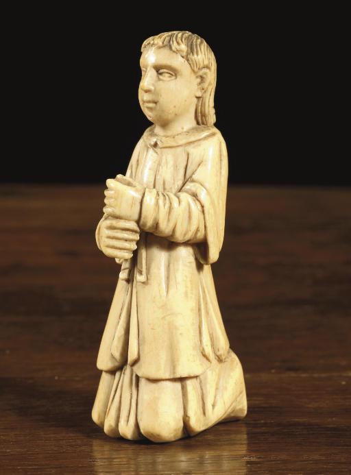 A carved ivory figure of a kne