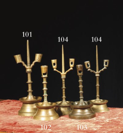 Two brass pricket candlesticks