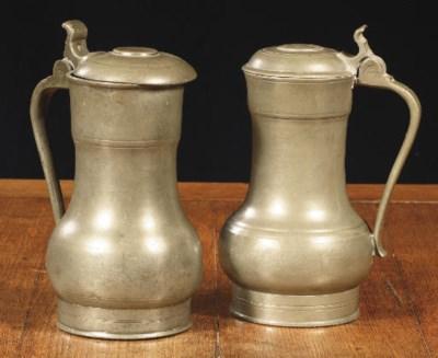 Two Dutch pewter flagons,