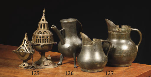 Two brass pear shaped measures