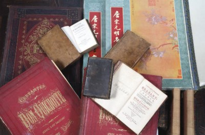 A collection of nine books, th