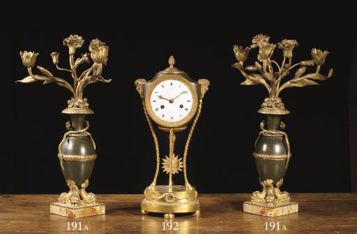 A pair of ormolu, patinated br