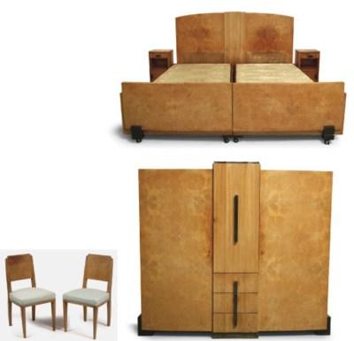 An Art Deco plane veneered bed