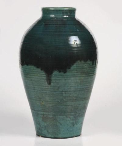 A large green glazed pottery v