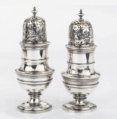 A pair of Dutch silver sugar c