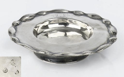A circular plate on high stand