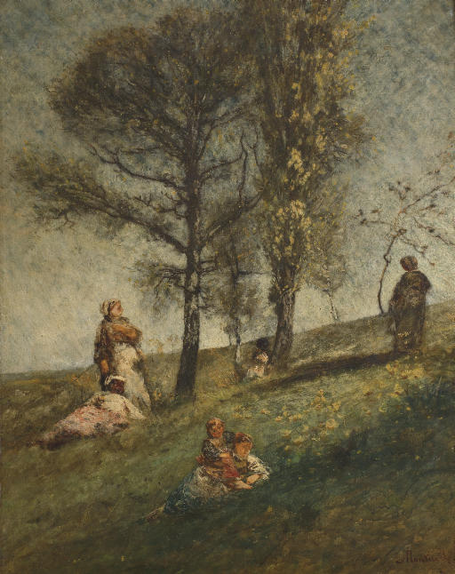 A young family under trees on a hill