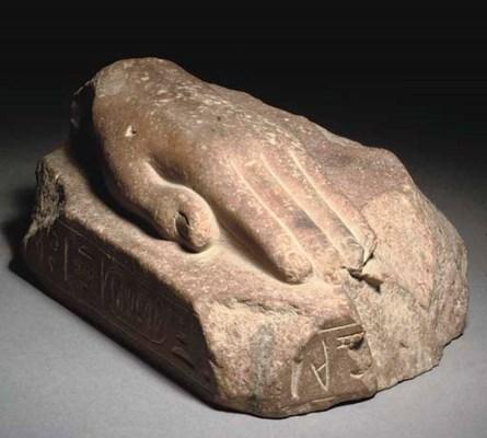 AN EGYPTIAN BROWN QUARTZITE 'R