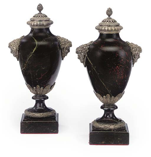 A PAIR OF SILVERED METAL-MOUNT