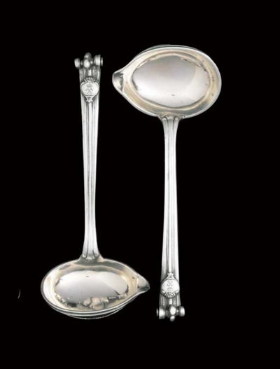 A PAIR OF DANISH SILVER SAUCE-