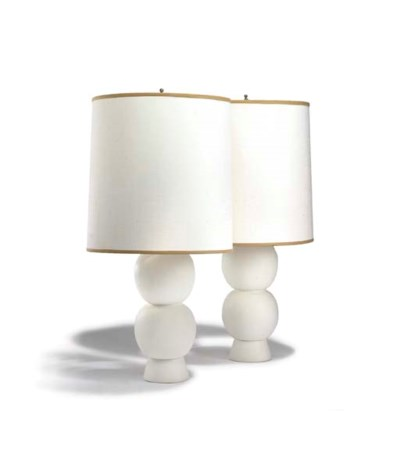 A PAIR OF WHITE CERAMIC LAMPS
