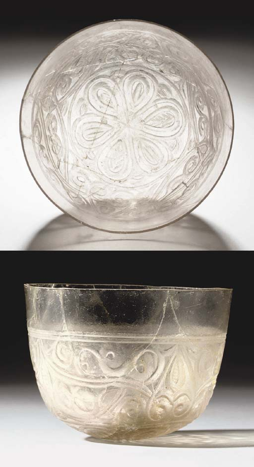 A WHEEL CUT GLASS BEAKER