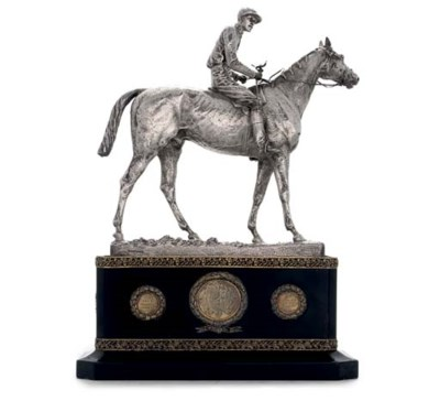 A VICTORIAN SILVER TROPHY IN T
