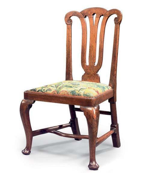 A GEORGE I WALNUT SIDE CHAIR