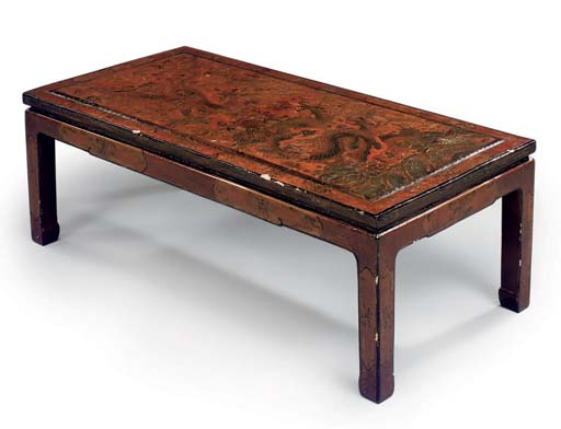 A CHINESE RED LACQUER LOW TABL