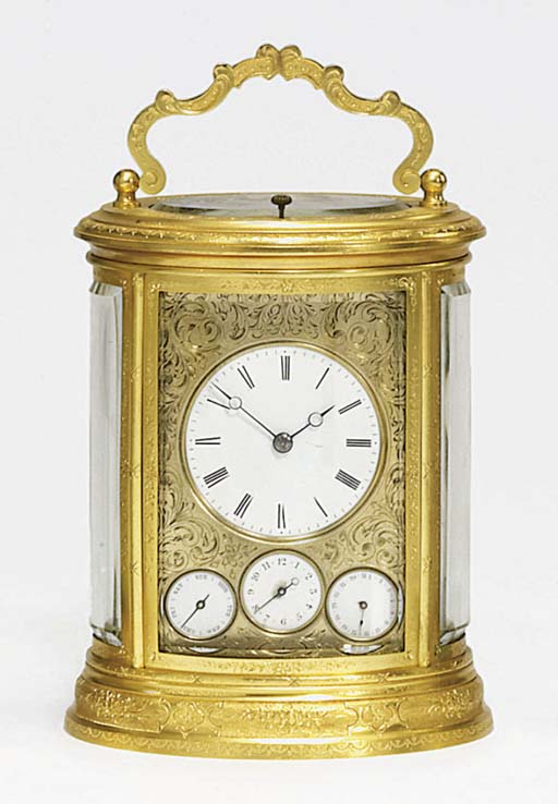 A French engraved gilt-brass striking and repeating eight day carriage clock with calendar and alarm
