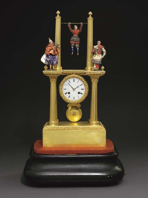 Acrobat and Musicians A Louis Philippe gilt-brass eight day striking and musical portico clock with automaton acrobat and musicians