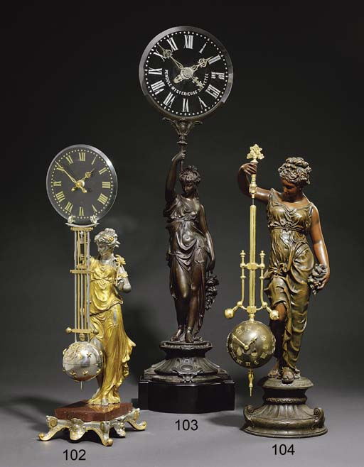 A French spelter and glass fig
