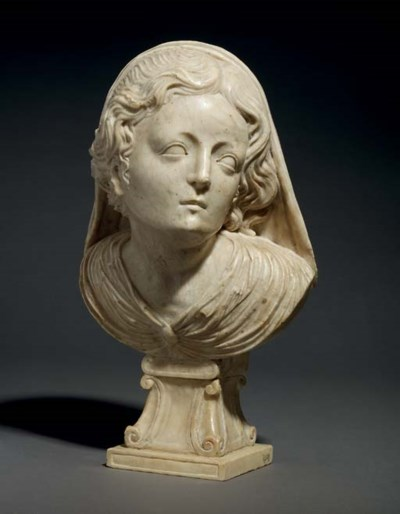 A CARVED MARBLE HEAD OF A WOMA