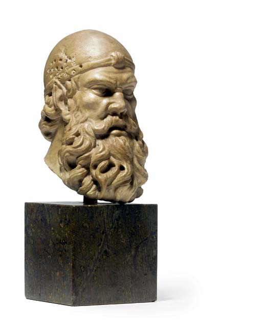 A CARVED MARBLE HEAD OF A BEAR