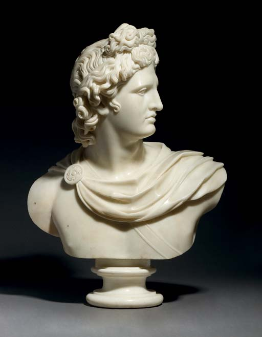 A CARVED MARBLE BUST OF THE AP