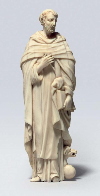 A CARVED IVORY FIGURE OF A MAL