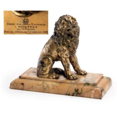 A GILT-BRONZE MODEL OF A LION