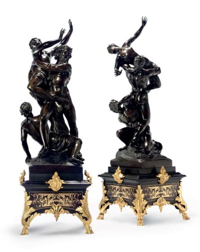 A PAIR OF BRONZE ABDUCTION GRO