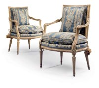 A PAIR OF SOUTH ITALIAN CREAM-PAINTED AND PARCEL-GILT OPEN ARMCHAIRS