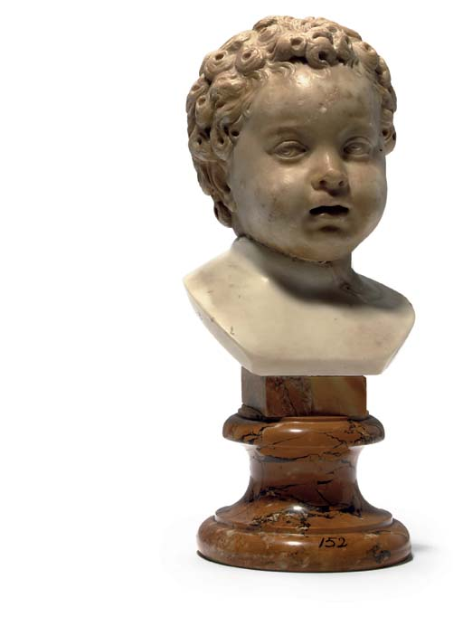 A CARVED MARBLE HEAD OF A PUTT